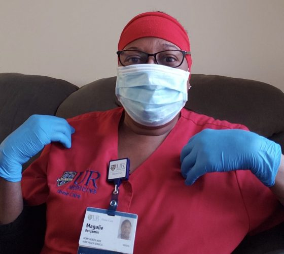 Magalie Benjamin, a Home Health Aide at UR Medicine Home Care, gets ready to visit a patient.